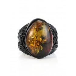 Leather ring close sparkling greenish cherry oval amber
