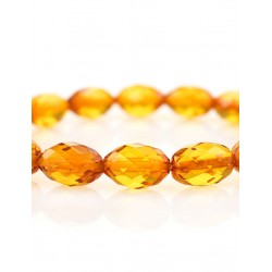 "Beautiful bracelet made of natural golden cognac Baltic amber ""Olive Diamond"""