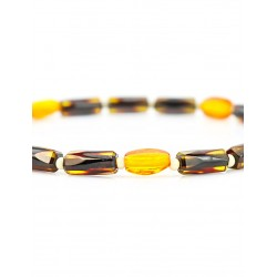 Light amber bracelet of small cylinders with diamond cut gold and cherry flowers