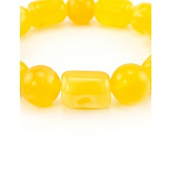 "Close bracelet made of natural Baltic amber bright honey-colored ""ball through the barrel"""