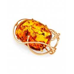"Bright pendant-brooch made of natural Baltic amber cognac ""Veneto"""
