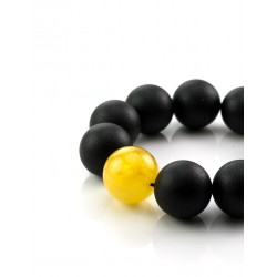 """Bracelet made of natural Baltic amber molded black, decorated with contrasting bead """"Cuba"""""""