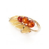 Impressive brooch decorated with natural cognac amber Beoluna