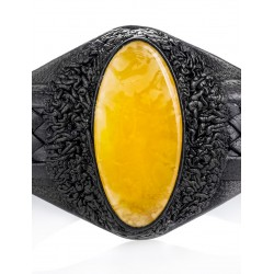 Bracelet made of black genuine leather with an oval inset of honey amber