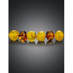 "Beads from natural amber of different shades of ""Pebbles round honey and cognac"""