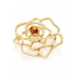 Openwork gilt brooch decorated with natural amber Beoluna