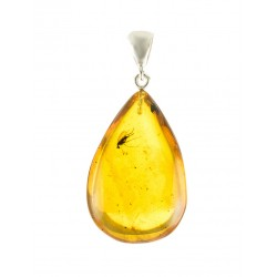 Big pendant in silver of cognac amber with a large inclusion