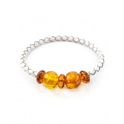 Bracelet made of white leather with beads made from natural amber brandy