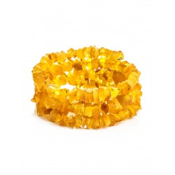 Bracelet made of natural unpolished amber on a string in three turns