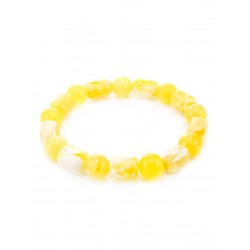 """Bracelet made of natural Baltic amber piece """"ball and barrel milk and honey"""""""