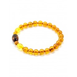 """Bracelet from amber balls cognac color with a diamond face """"Caramel"""""""