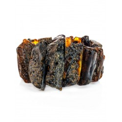 """Bracelet on the wrist of a wide natural amber with a wild crust """"Pompeii"""""""