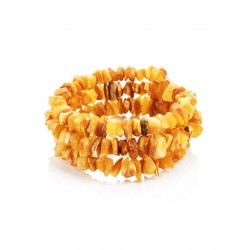 Bracelet on a string of natural unpolished amber with a therapeutic effect