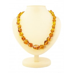 "Beads from natural amber transparent cognac color ""Lollipops"""