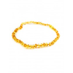 "Beads from natural amber baby ""Pebbles golden cognac"" for children"