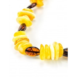 "Beads from natural Baltic amber of different colors ""and pebble Olive"""