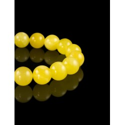 Bracelet amber beads from solid honey-colored balls,