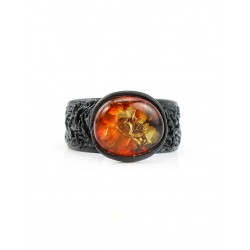 Ring made of genuine leather with sparkling greenish-cherry amber