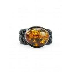Ring made of genuine leather with amber-gold color of tea