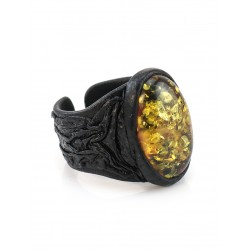 Leather ring with large green sparkling amber