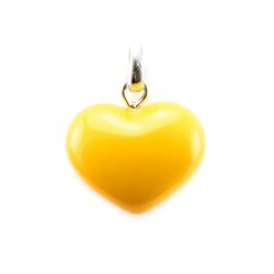 Beautiful glossy heart-shaped pendant made of natural amber