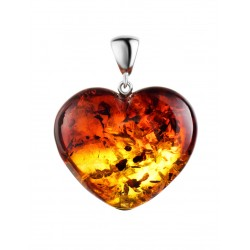 Beautiful gradient heart-shaped pendant made of natural amber
