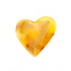 Large asymmetrical heart-shaped pendant made of natural amber honey