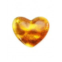 Large heart-shaped pendant made of natural amber transparent greenish-lemon color with beautiful natural crust