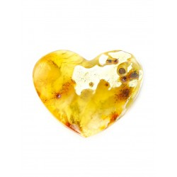 A large pendant made of natural amber with a variety of beautiful texture in the form of a heart