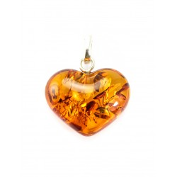 "Pendant made of solid natural amber ""Heart"" with cognac-colored sparkles"
