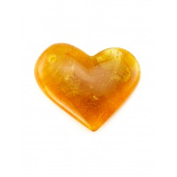 Pendant in the form of asymmetric heart of the natural honey-bright translucent amber
