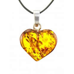 A pendant in the shape of a heart made of natural sparkling amber-colored brandy