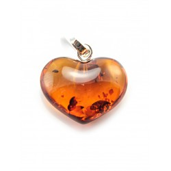 A pendant in the shape of a heart made of natural roasted amber