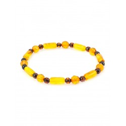 Light amber bracelet cognac small cylinders of golden balls with the diamond cut and cherry balls