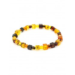 Light amber bracelet of transparent cubes and cherry brandy balls
