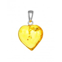 A small heart-shaped pendant made of natural Baltic amber lemon