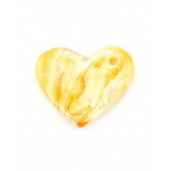 A small heart-shaped pendant made of natural milk-honey-amber with a beautiful watercolor texture
