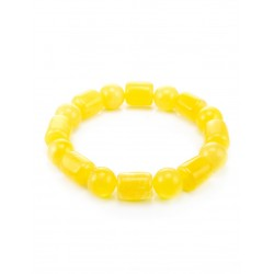 """Delicate bracelet made of natural solid amber """"Ball and barrel of honey"""""""