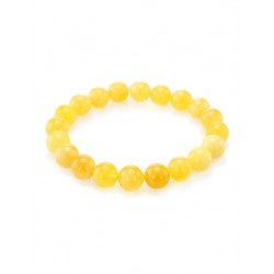 """Gentle bracelet in a classic style """"balls"""" made of natural Baltic amber honey"""