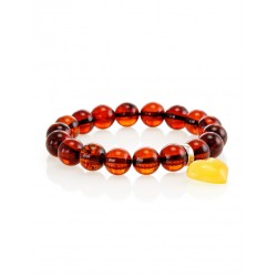 """Charming bracelet made of natural amber """"ball"""" with a pendant-heart"""
