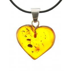 Pendant in the shape of a heart made of natural Baltic amber cognac