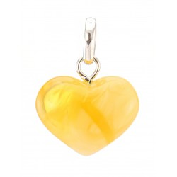 Pendant in the shape of a heart made of natural amber honey with a unique texture