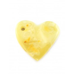 Pendant in the shape of a heart with natural milk-white amber with a beautiful landscape bluish texture