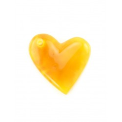 Pendant in the shape of a heart made of natural amber honey-saturated colors