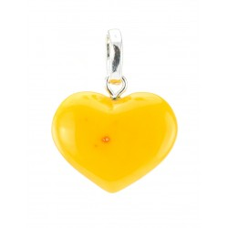 Pendant in the shape of a heart made of solid natural honey amber with aging effect
