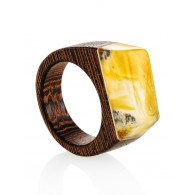 "Stylish ring made of wood with a piece of natural Baltic amber with the natural texture of ""Indonesia"""