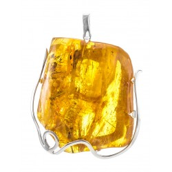 Delicious suspension of silver authoring with inclusions and amber