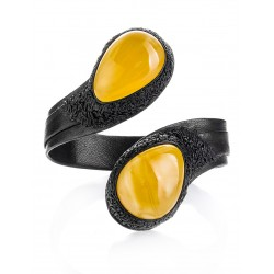 """Bright black leather bracelet on a rigid base, decorated with amber inserts """"Snake"""""""