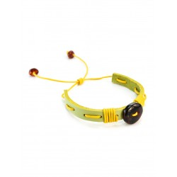 Bright leather bracelet light green, yellow lace interwoven with cherry amber