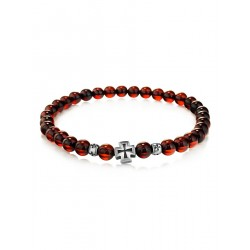 Bright light bracelet made of natural cherry amber with a silver cross